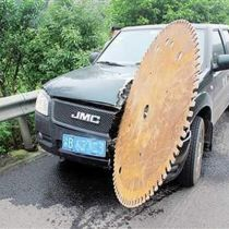 Chongqing man cheats death as 60-inch circular saw crashes into truck