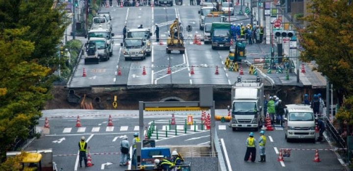 Massive sinkhole opens on busy road near subway station in Japan