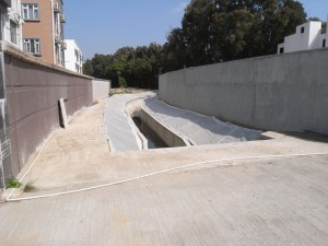 The completed reinstatement of the river channel at Kam Tsin Tsuen showing the precast pipes left in. The village houses on the right behind the wall were completed last year. Photo taken on 30 Jan 2013 (Danny Chung)