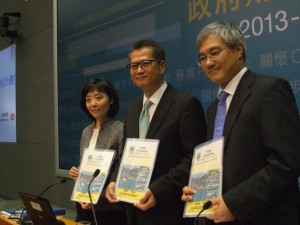 Secretary for Development Paul Chan Mo-po (centre) announcing the new land sales programme for the 2013-14 financial year  (Danny Chung)