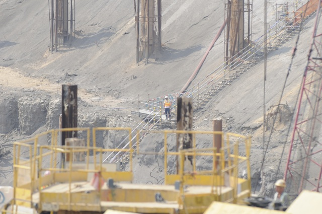 Digging a very big hole. The government is still insisting that the Express Rail Link will be completed on time in 2015 and on budget. (Danny Chung)