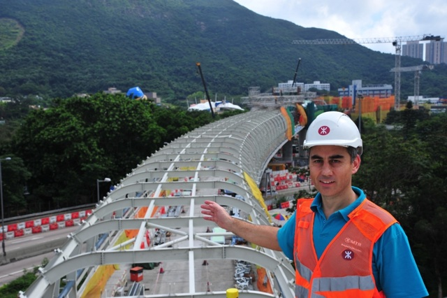 """""""We use the latest proven techniques to minimize the impact to the community. With the """"Beam-and-Winch"""" equipment, not only do we complete the South Island Line (East) project faster, the residents can also enjoy the convenience of a rail service sooner,"""" says MTRC's lead project manager – SIL, Mark Cuzner.   (MTR Corporation)"""