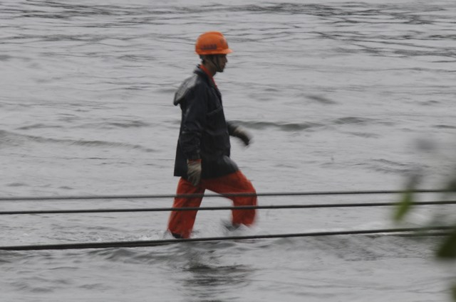 A worker on the precast unit, seemingly walking on water  (Danny Chung)