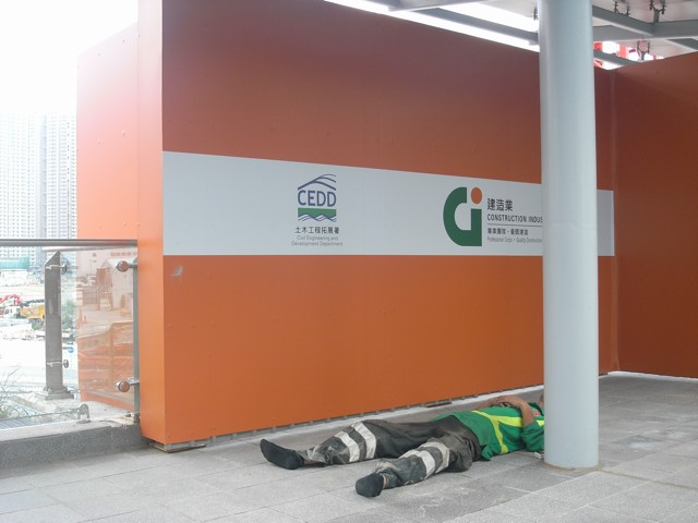 A construction worker taking a lunchtime nap at the Kai Tak Development on 4 July 2013.  It's likely he'll be taking more lunchtime naps for the next few years with the HK$38.5 billion of public works awarded in July 2013   (Danny Chung)