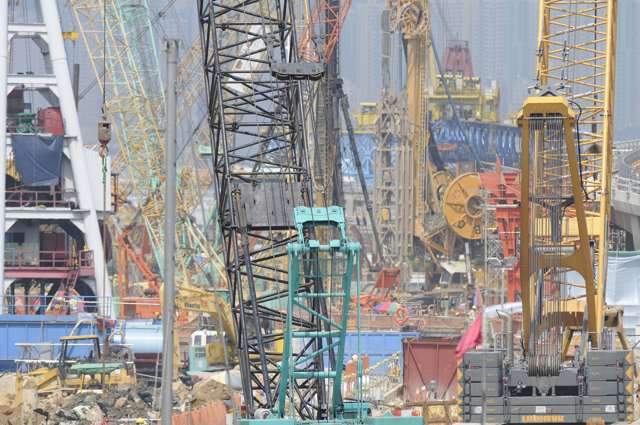 The construction site at Causeway Bay Typhoon Shelter appears jam packed with construction machinery in this photo, a result of the compression of the foreground and background when using a long telephoto lens   (Danny Chung)
