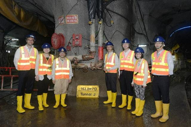 Secretary for the Environment Wong Kam-sing (fourth from right) and other guests at the lowest point of the HATS Stage 2A sewage tunnel, at 163.8 metres below sea level   (HKSAR Government)