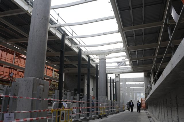 At track level, though the railway tracks are not yet laid, showing the central opening in the roof for natural light illumination of the platforms  (Danny Chung)