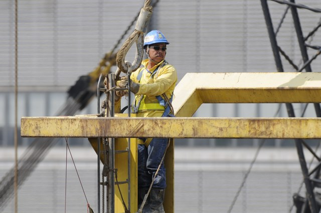 Construction workers enjoyed healthy wage increases during 2013 as heavy demand for labour demand on public works and private sector projects drove up wages   (Danny Chung)