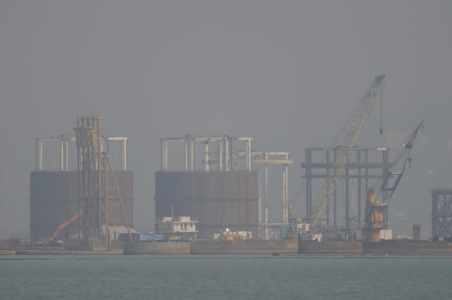 Reclamation currently in progress for the Hong Kong Boundary Crossing Facilities in this photo taken on 10 January 2014. The government will carry out a study on the infrastructure required for major commercial development on the artificial island  (Danny Chung)