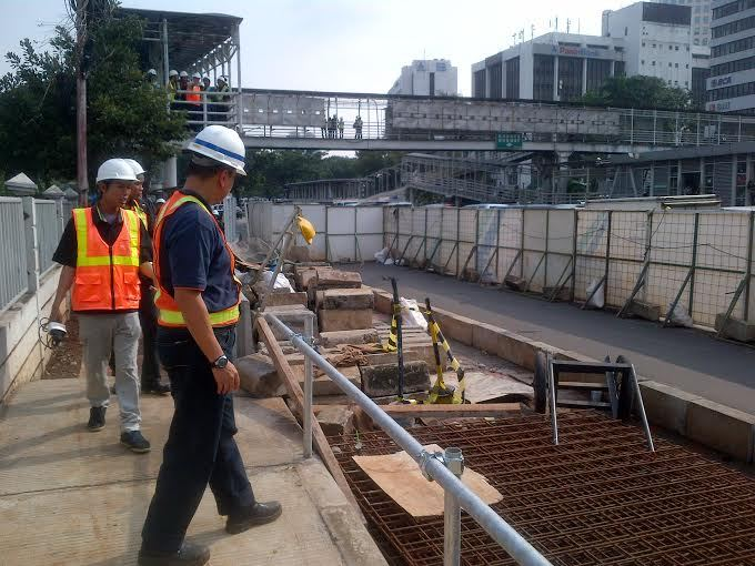 Construction Workers inspect part of the Jakarta MTR line