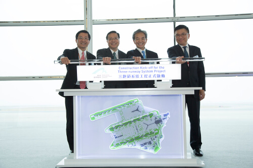 Jack So Chak-kwong, Chairman of Airport Authority Hong Kong (AA) (second right), Professor Anthony Cheung Bing-leung, Secretary for Transport and Housing (second left), Professor K C Chan, Secretary for Financial Services and the Treasury (first right), and Fred Lam, Chief Executive Officer of the AA (first left) officiate the kick-off of the Three-runway System (3RS) construction.